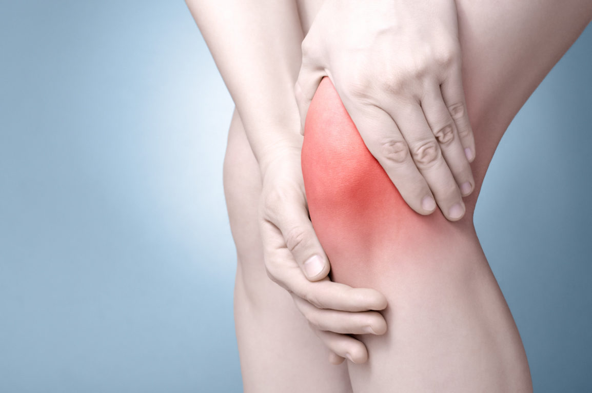 young-woman-massaging-her-painful-knee